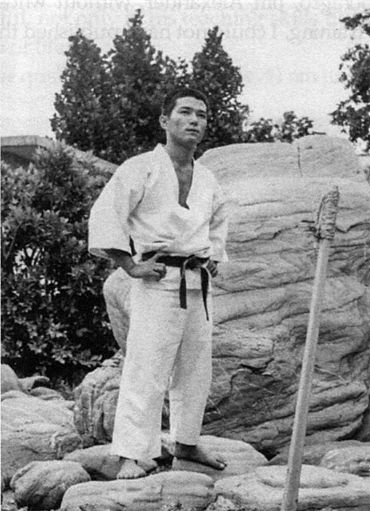 Sensei Takayoshi Nagamine with Makiwara in Okinawa Before Coming to the USA in 1967